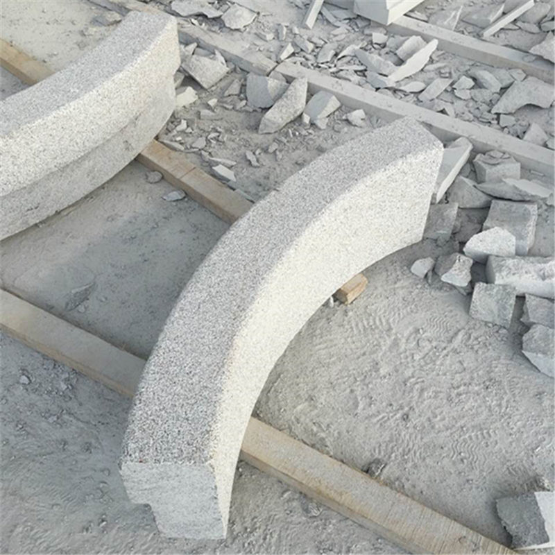 Radius kerbs road safety barriers